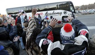 Fans wave as a bus carrying New England Patriots NFL football players and staff arrives at Gillette Stadium, in Foxborough, Mass., Monday, Feb. 5, 2018, after the team's loss to the Philadelphia Eagles in the NFL Super Bowl in Minneapolis, Sunday. (AP Photo/Steven Senne)