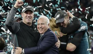 Philadelphia Eagles head coach Doug Pederson, left, hugs owner Jeffrey Lurie as they celebrate after beating the New England Patriots in the NFL Super Bowl 52 football game Sunday, Feb. 4, 2018, in Minneapolis. (AP Photo/Frank Franklin II)