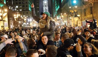 Philadelphia Eagles fans celebrate the team's victory in the NFL Super Bowl 52 between the Philadelphia Eagles and the New England Patriots, Sunday, Feb. 4, 2018, in downtown Philadelphia. (AP Photo/Matt Rourke)