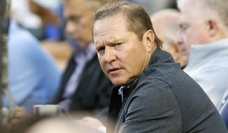 FILE - In this  Tuesday, Aug. 11, 2015, file photo, sports agent Scott Boras attends the baseball game between the Los Angeles Dodgers and Washington Nationals in Los Angeles. Agent Scott Boras says the number of major league teams rebuilding with younger, lower-cost rosters has become a cancer to the sport, attributing behavior to the strengthened luxury tax combining with restraints on draft-pick salaries. (AP Photo/Danny Moloshok, File)
