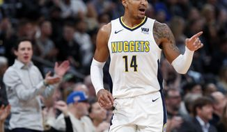 Denver Nuggets guard Gary Harris gestures after hitting a three-point basket against the Charlotte Hornets in the first half of an NBA basketball game Monday, Feb. 5, 2018, in Denver. (AP Photo/David Zalubowski)