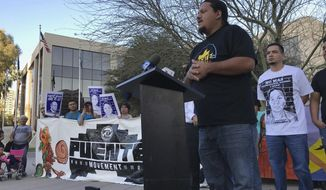 Carlos Garcia, executive director of the immigrant advocate group Puente, addresses a rally of some 40 people outside the U.S. Immigration and Customs Enforcement building in Phoenix, Monday, Feb. 5, 2018. A year ago, immigrant mother Guadalupe Garcia de Rayos was arrested and deported back to her native Mexico. Her case became a cause celebre for advocates who say President Donald Trump's immigration policies hurt families. Her attorney is seeking to reopen her case for using a fraudulent ID to get a job, a conviction that made her vulnerable to deportation under Trump after enjoying leniency during the Obama administration. (AP Photo/Anita Snow)