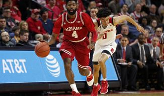 Indiana guard Robert Johnson (4) brings the ball upcourt in front of Rutgers guard Geo Baker (0) during the first half of an NCAA college basketball game Monday, Feb. 5, 2018, in Piscataway, N.J. (AP Photo/Adam Hunger)