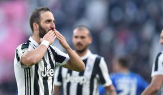 Juventus' Gonzalo Higuain celebrates after scoring a goal during the Italian Serie A soccer match between Juventus and Sassuolo at the Allianz Stadium in Turin, Italy, Sunday, Feb. 4, 2018. Higuain scored an hat trick in Juventus 7 - 0 victory. (Alessandro Di Marco/ANSA via AP)