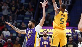 Utah Jazz guard Rodney Hood (5) shoots a 3-point shot at the buzzer to end the first half of an NBA basketball game in New Orleans, Monday, Feb. 5, 2018. (AP Photo/Gerald Herbert)