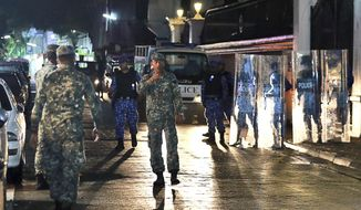 Maldives defence soldiers patrol on the main street of Male, Maldives, Monday, Feb. 5, 2018. The Maldives government has declared a 15-day state of emergency as the political crisis deepens in the Indian Ocean nation amid an increasingly bitter standoff between the president and the Supreme Court. (AP Photo/ Mohamed Sharuhaan)
