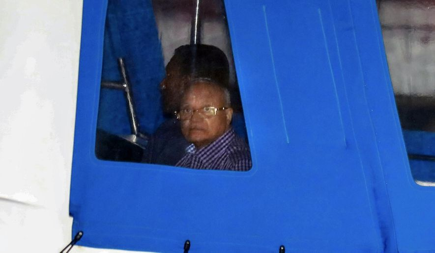 Former Maldives president and opposition leader Maumoon Abdul Gayoom is being taken to prison by police after the government declared a 15-day state of emergency in Male, Maldives, early Tuesday, Feb. 6, 2018. The Maldives government declared a 15-day state of emergency Monday as the political crisis deepened in the Indian Ocean nation amid an increasingly bitter standoff between the president and the Supreme Court. Hours after the emergency was declared, soldiers forced their way into the Supreme Court building, where the judges were believed to be taking shelter, said Ahmed Maloof, an opposition member of Parliament. (AP Photo/Mohamed Sharuhaan)