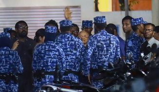Policemen arrest former Maldives president and opposition leader Maumoon Abdul Gayoom, center, after the government declared a 15-day state of emergency in Male, Maldives, early Tuesday, Feb. 6, 2018. The Maldives government declared a 15-day state of emergency Monday as the political crisis deepened in the Indian Ocean nation amid an increasingly bitter standoff between the president and the Supreme Court. Hours after the emergency was declared, soldiers forced their way into the Supreme Court building, where the judges were believed to be taking shelter, said Ahmed Maloof, an opposition member of Parliament. (AP Photo/Mohamed Sharuhaan)