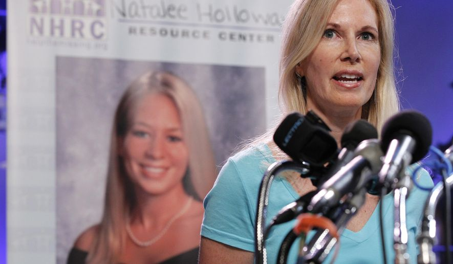 "FILE - In this June 8, 2010, file photo, Beth Holloway, mother of Natalee Holloway, speaks during the opening of the Natalee Holloway Resource Center (NHRC) at the National Museum of Crime & Punishment in Washington. Beth Holloway claims in the federal lawsuit filed Friday, Feb. 2, 2018, that the deception surrounding ""The Disappearance of Natalee Holloway"" was so complete she was even tricked her into providing a DNA sample to match against what producers claimed were remains that could be those of her long-missing daughter.(AP Photo/Pablo Martinez Monsivais, File)"
