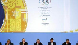 International Olympic Committee President Thomas Bach, bottom center, leads the 132nd IOC Session prior to the 2018 Winter Olympics in Pyeongchang, South Korea, Tuesday, Feb. 6, 2018. (AP Photo/Patrick Semansky)
