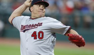 File-This Sept. 26, 2017, file photo shows Minnesota Twins starting pitcher Bartolo Colon throwing against the Cleveland Indians during the first inning in a baseball game in Cleveland. Colon has agreed to a minor league contract with the Texas Rangers, and the 44-year-old right-hander will attend big league spring training. Colon would get a $1.75 million, one-year contract if added to the 40-man roster under the terms of the deal agreed to Sunday, Feb. 4, 2018.  (AP Photo/Ron Schwane, File)