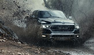 "This photo provided by Ram Truck Brand shows a scene from the company's Super Bowl spot. The Ram truck ad that used a speech by Martin Luther King, Jr., is drawing a backlash. The ad shows people doing service-oriented tasks set against audio of King's speech, which urges people to be ""great"" by serving the greater good rather than being successful. It was supposed to highlight the volunteer program Ram Nation. (Ram Truck Brand via AP)"