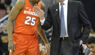 Syracuse head coach Jim Boeheim, right, talks with guard Tyus Battle (25) during the first half of an NCAA college basketball game against Louisville, Monday, Feb. 5, 2018, in Louisville, Ky. (AP Photo/Timothy D. Easley)