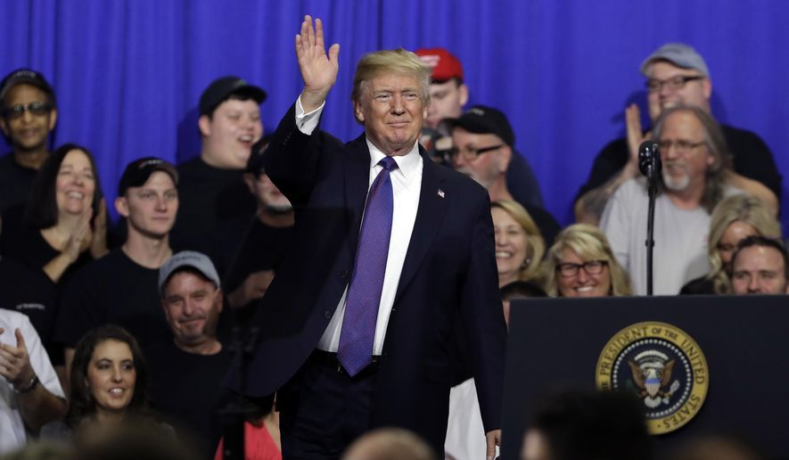 President Trump is getting encouragement from polls showing a rising job approval rating and a narrowing of the generic ballot for midterm elections. (Associated Press/File)