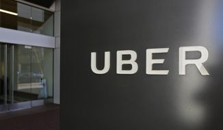 FILE - This Wednesday, March 1, 2017, file photo shows an exterior view of the headquarters of Uber in San Francisco. A trial opening Monday, Feb. 5, 2018, in San Francisco federal court comes nearly a year after Google spin-off Waymo accused Uber of ripping off its self-driving car technology after paying $680 million for a startup run by a former Google engineer.   (AP Photo/Eric Risberg, File)