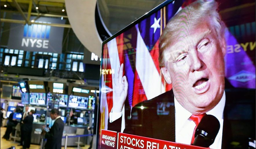 President Trump's image looms over the New York Stock Exchange, even as many news organizations tried to blame him for the plunge. (Associated Press)