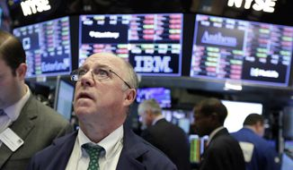 In this file photo, trader Frederick Reimer is shown on the floor of the New York Stock Exchange, Tuesday, Feb. 6, 2018. AP Photo/Richard Drew)