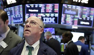 Trader Frederick Reimer works on the floor of the New York Stock Exchange, Tuesday, Feb. 6, 2018. The Dow Jones industrial average fell as much as 500 points in early trading, bringing the index down 10 percent from the record high it reached on Jan. 26. The DJIA quickly recovered much of that loss. (AP Photo/Richard Drew)