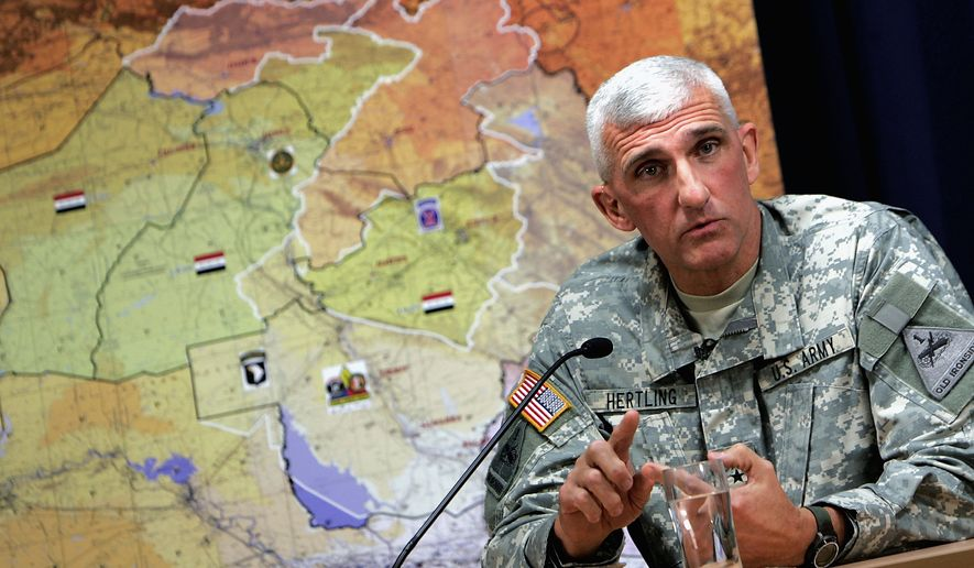 U.S. Army Maj. Gen. Mark P. Hertling , commander of Multi-National Division - North, speaks to reporters on Wednesday, Dec. 19, 2007 during a press conference about recent efforts against al-Qaida with Maj. Gen. Kevin J. Bergner (not pictured) , Multi-National Force  Iraq spokesman in Baghdad, Iraq.  (AP Photo/Wathiq Khuzaie, Pool)