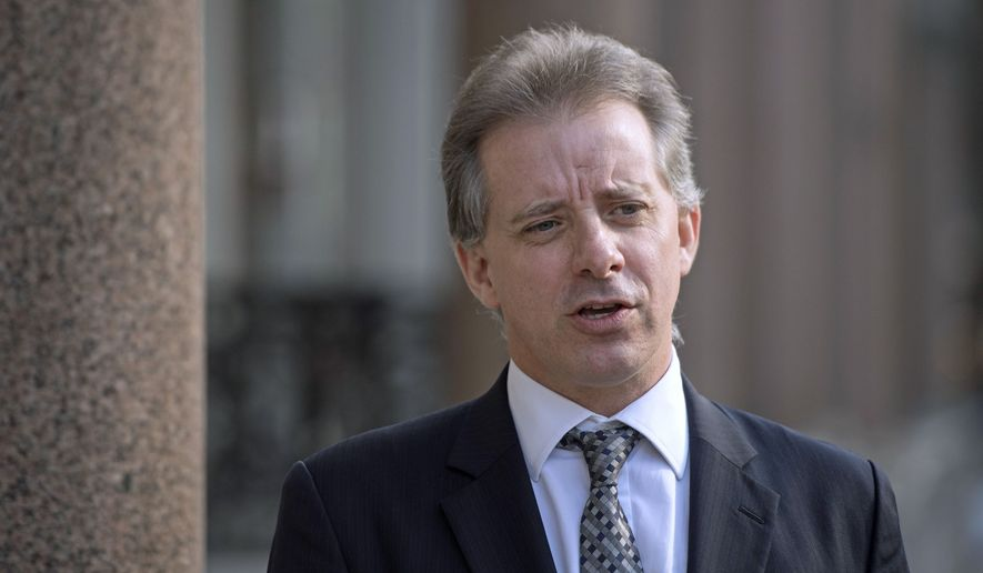 """Christopher Steele, former British intelligence officer, in London Tuesday, March 7, 2017. Steele who compiled an explosive and unproven dossier on President Donald Trump's purported activities in Russia has returned to work. Christopher Steele said Tuesday he is """"really pleased"""" to be back at work in London after a prolonged period out of public view. He went into hiding in January. (Victoria Jones/PA via AP) ** FILE **"""