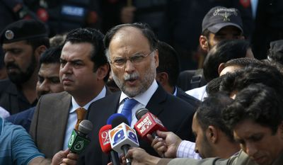 Pakistani Interior Minister Ahsan Iqbal talks to media outside the accountability court where Pakistan's former Prime Minister Nawaz Sharif appeared, in Islamabad, Pakistan, Monday, Oct. 2, 2017. A Pakistani court has postponed the indictment of former Prime Minister Nawaz Sharif for a week after his children, who are co-defendants in the case, did not appear in court. The court on Monday set Oct. 9 for the indictments against Sharif, his two sons, daughter and son in-law. (AP Photo/Anjum Naveed)