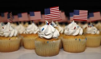 Cupcakes adorned with American flags sit on trays for supporters of Jack Phillips, owner of Masterpiece Cake, after a rally on the campus of a Christian college Wednesday, Nov. 8, 2017, in Lakewood, Colo. The small rally was held to build support for Phillips, who is at the center of a case that will be considered by the U.S. Supreme Court in December. The case may determine if business owners like Phillips are having their right of religious liberty and free expression violated by having to offer their wedding services to same-sex couples. (AP Photo/David Zalubowski) ** FILE **