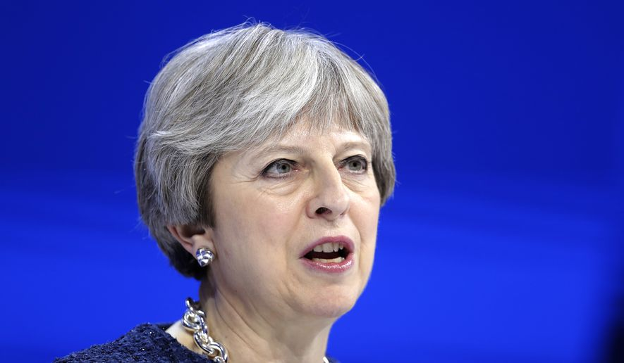 British Prime Minister Theresa May delivers a speech during the annual meeting of the World Economic Forum in Davos, Switzerland, Thursday, Jan. 25, 2018. (AP Photo/Markus Schreiber)