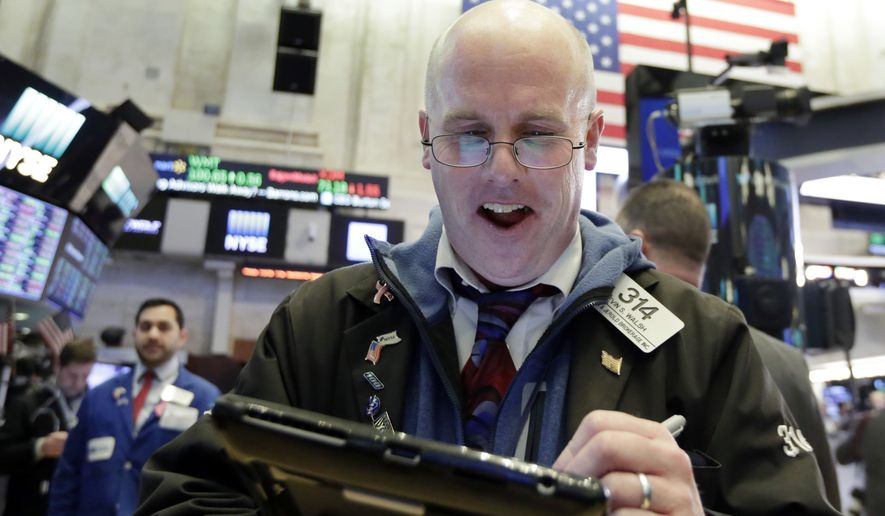 Trader Kevin Walsh works on the floor of the New York Stock Exchange at the closing bell Tuesday, Feb. 6, 2018. Stocks closed sharply higher on Wall Street after another turbulent day of steep ups and downs. (AP Photo/Richard Drew)