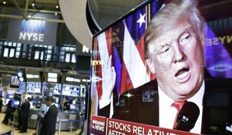 FILE- In this Nov. 9, 2016, file photo an image of President-elect Donald Trump appears on a television screen on the floor of the New York Stock Exchange. President Trump has maintained an uncharacteristic silence since the stock market took a nose dive, notable for a businessman president who regularly points to the rising market as evidence of the success of his presidency and economic policies. (AP Photo/Richard Drew, File)