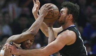 Dallas Mavericks guard Dennis Smith Jr., left, hits Los Angeles Clippers forward Danilo Gallinari, of Italy, in the face with the ball as he tries to pass during the second half of an NBA basketball game, Monday, Feb. 5, 2018, in Los Angeles. Smith was charged with an offensive foul on the play. The Clippers won 104-101. (AP Photo/Mark J. Terrill)
