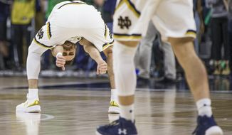 Notre Dame's Matt Farrell gestures between his legs during the second half of an NCAA college basketball game against Boston College on Tuesday, Feb. 6, 2018, in South Bend, Ind. Notre Dame won 96-85. (AP Photo/Robert Franklin)