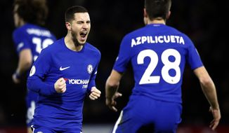 Chelsea's Eden Hazard, left, celebrates with teammate Cesar Azpilicueta after scoring his side's first goal during the English Premier League soccer match between Watford and Chelsea at Vicarage Road stadium in London, Monday, Feb. 5, 2018.(AP Photo/Frank Augstein)