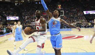 Chicago Bulls guard Jerian Grant, left, goes to the basket against Sacramento Kings guard Buddy Hield during the second half of an NBA basketball game Monday, Feb. 5, 2018, in Sacramento, Calif. (AP Photo/Rich Pedroncelli)