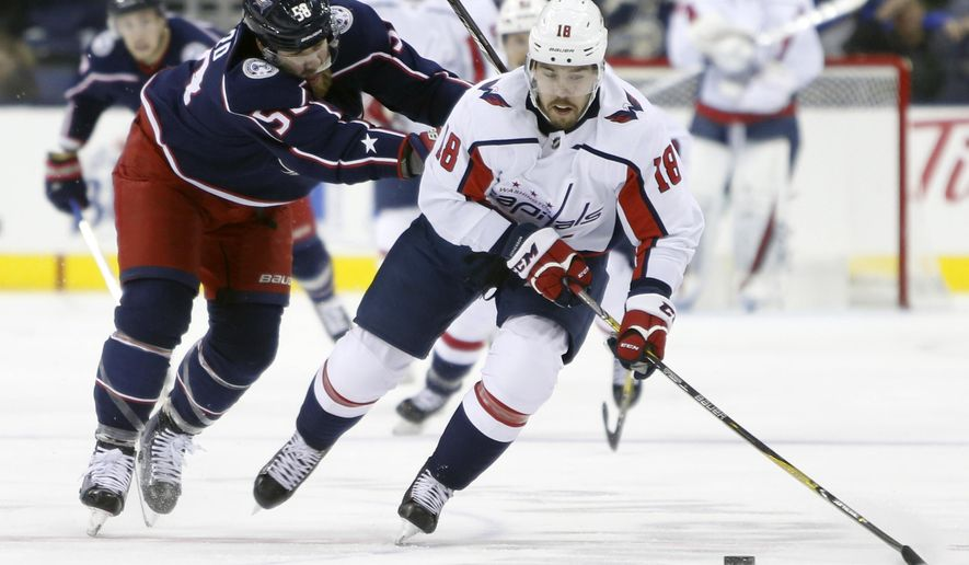 Washington Capitals' Chandler Stephenson, right, carries the puck up ice as Columbus Blue Jackets' David Savard defends during the first period of an NHL hockey game Tuesday, Feb. 6, 2018, in Columbus, Ohio. (AP Photo/Jay LaPrete) ** FILE **