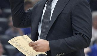 Cleveland Cavaliers head coach Tyronn Lue checks his notes during a timeout in the first half of NBA basketball game against the Orlando Magic Tuesday, Feb. 6, 2018, in Orlando, Fla. (AP Photo/Phelan M. Ebenhack)