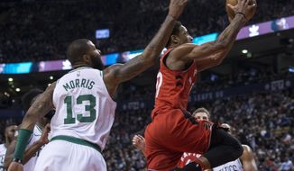 Toronto Raptors DeMar DeRozan goes to the basket past Boston Celtics Marcus Morris during the second half of an NBA basketball game Tuesday, Feb. 6, 2018, in Toronto. (Chris Young/The Canadian Press via AP)