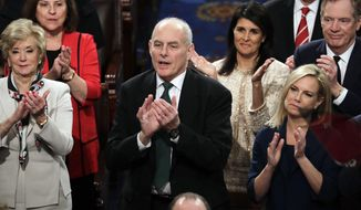 "In this Jan. 30, 2018 photo, White House Chief of Staff John Kelly applauds President Donald Trump at his first State of the Union address, at the Capitol in Washington. Kelly has told a small group of reporters, Tuesday, Feb. 6, 2018 at the Capitol that ""Dreamers"" would not be a priority for deportation, even if their Obama-era protections expire and a deadlocked Congress hasn't completed a deal to protect them.  (AP Photo/J. Scott Applewhite)"