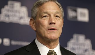 FILE - In a Dec. 5, 2017 file photo, University of Iowa NCAA college football head coach Kirk Ferentz speaks to reporters during a news conference in New York. Attorneys for Iowa football coach Kirk Ferentz and his neighbors say they've settled a dispute over a private road and the coach's refusal to join a homeowner's association. A trial was scheduled to start Tuesday, Feb. 6, 2018, in the dispute that pitted Iowa's highest-paid public employee and his wife against the three other families who live on Saddle Club Road outside Iowa City. (AP Photo/Seth Wenig)