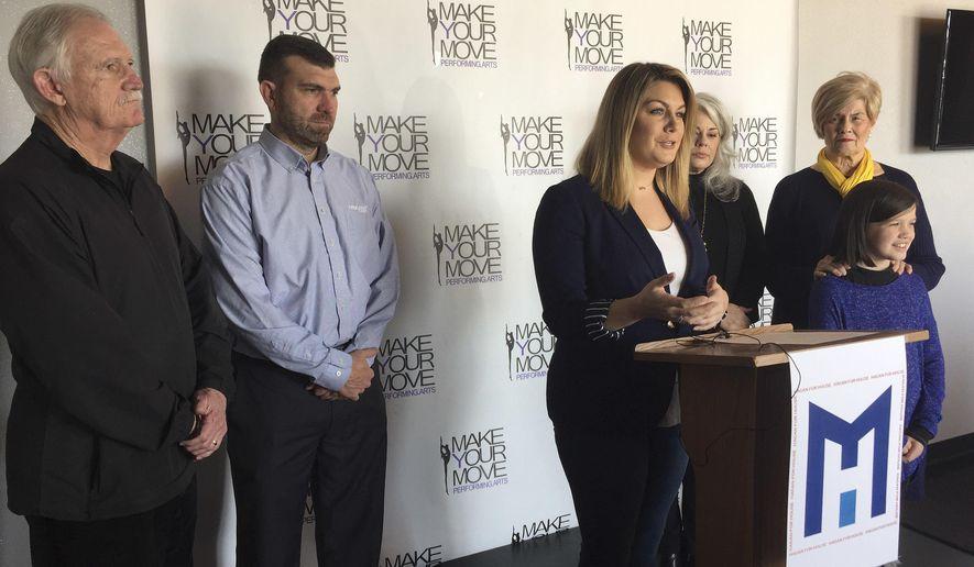 Former Miss America Mallory Hagan, center, of Opelika, Ala., announces her Democratic bid for Alabama's District 3 seat, Tuesday, Feb. 6, 2018, in Opelika. (Howard Koplowitz/AL.com via AP)