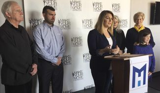 Former Miss America Mallory Hagan, center, of Opelika, Ala., announces her Democratic bid for Alabama's District 3 seat, Tuesday, Feb. 6, 2018, in Opelika. (Howard Koplowitz/AL.com via AP)