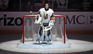 Vegas Golden Knights goaltender Marc-Andre Fleury stands during the national anthem before the team's NHL hockey game against his former team, the Pittsburgh Penguins, in Pittsburgh on Tuesday, Feb. 6, 2018. It was Fleury's first trip back to Pittsburgh for a game since being taken in the expansion draft by the Golden Knights. (AP Photo/Gene J. Puskar)
