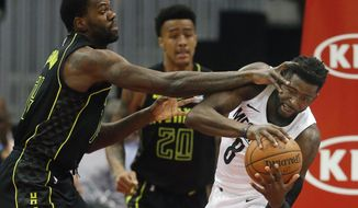 Memphis Grizzlies forward James Ennis III (8) is defended by Atlanta Hawks center Dewayne Dedmon (14) as he works in the first half of an NBA basketball game Tuesday, Feb. 6, 2018, in Atlanta. (AP Photo/John Bazemore)