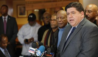 J.B. Pritzker speaks to the media as Illinois Secretary of State Jesse White and others look on at MacArthur's Restaurant in Chicago on Tuesday, Feb. 6, 2018. (Jose M. Osorio/Chicago Tribune via AP)