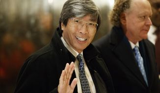 FILE - In this Jan. 10, 2017, file photo, pharmaceuticals billionaire Dr. Patrick Soon-Shiong waves as he arrives in the lobby of Trump Tower in New York for a meeting with President-elect Donald Trump. The Los Angeles Times is reporting its parent company is in talks to be sold to Soon-Shiong. The Washington Post first reported Tuesday, Feb. 6, 2018 that the sale was being negotiated by Tronc Inc., formerly Tribune Publishing. The Times then reported that the price was $500 million and would include the San Diego Union-Tribune. Chicago-based Tronc owns 10 U.S. newspapers. (AP Photo/Evan Vucci, File)