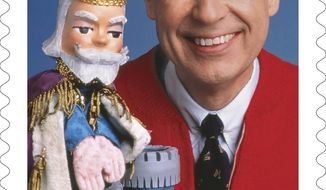 "This image released by the United States Postal Service shows a postage stamp featuring Fred Rogers from the PBS children's television series ""Mister Rogers' Neighborhood"" with his King Friday XIII puppet. The U.S. Postal Service plans to issue a new stamp on March 23 in the same Pittsburgh public television station where the program was produced. Rogers died in 2003 at 74 after battling stomach cancer. (USPS via AP)"