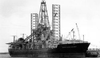 """FILE - This March 19, 1975 file photo shows the Hughes Glomar Explorer, a 618-foot-long salvage ship built by the eccentric industrialist Howard Hughes, at the Long Beach harbor dock in Los Angeles, Calif. A Cold War-era legal tactic to conceal information, named the Glomar doctrine after the ship, was coined when the CIA said it would """"neither confirm nor deny"""" whether records existed on a 1970's mission that used the Hughes Glomar Explorer to retrieve a portion of a Soviet submarine that had sunk in the Pacific Ocean. Now New York's highest court will consider whether the New York Police Department can use the Glomar doctrine to conceal information about whether it put Muslims under surveillance. (AP Photo, File)"""