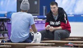 Canada's Alex Boivert-Lacroix chats with Shani Davis of the Unites States following a speed skating practice Monday, Feb. 5, 2018 in Gangneung. (Paul Chiasson/The Canadian Press via AP)