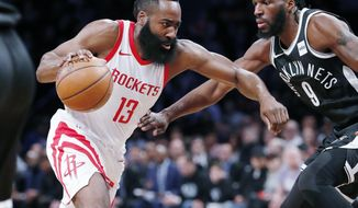 Houston Rockets guard James Harden (13) drives toward the basket as Brooklyn Nets forward DeMarre Carroll (9) defends during the first half of an NBA basketball game, Tuesday, Feb. 6, 2018, in New York. (AP Photo/Kathy Willens)