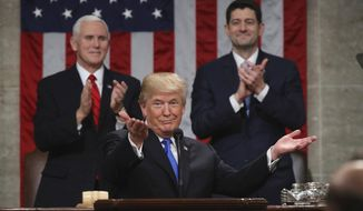 In this Jan. 30, 2018, file photo, President Donald Trump gestures as delivers his first State of the Union address in the House chamber of the U.S. Capitol to a joint session of Congress in Washington, as Vice President Mike Pence and House Speaker Paul Ryan applaud. (Win McNamee/Pool via AP, File)