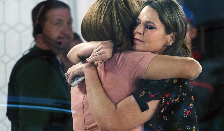 """FILE - In this Nov. 29, 2017 file photo, co-anchors Hoda Kotb, left, and Savannah Guthrie embrace on the set of the """"Today"""" show in New York after NBC News fired host Matt Lauer for """"inappropriate sexual behavior."""" Kotb believes the program's audience bonded with her and Guthrie over how they dealt with Lauer's firing last November. The NBC morning show weathered the storm better than anyone expected. It slipped past ABC's """"Good Morning America"""" into first place in the ratings for nearly two months, before ABC won the last two weeks. (AP Photo/Craig Ruttle, File)"""